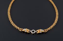 COLLAR Realizado en oro, con motivo central de oro bicolor y diamantes talla 8/8, peso total aproximado: 0.11 ct.